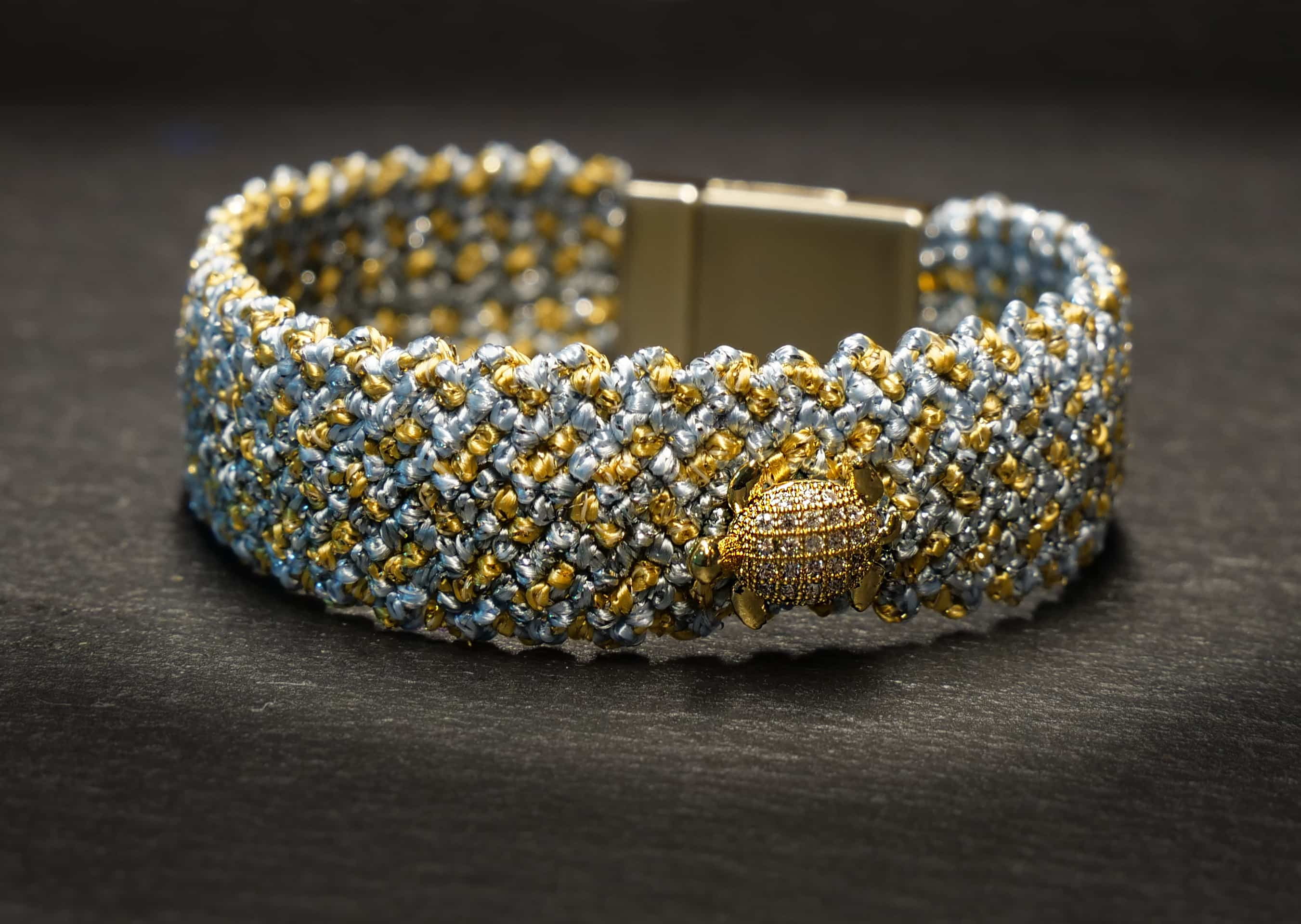 woven bracelet with turtle pendant