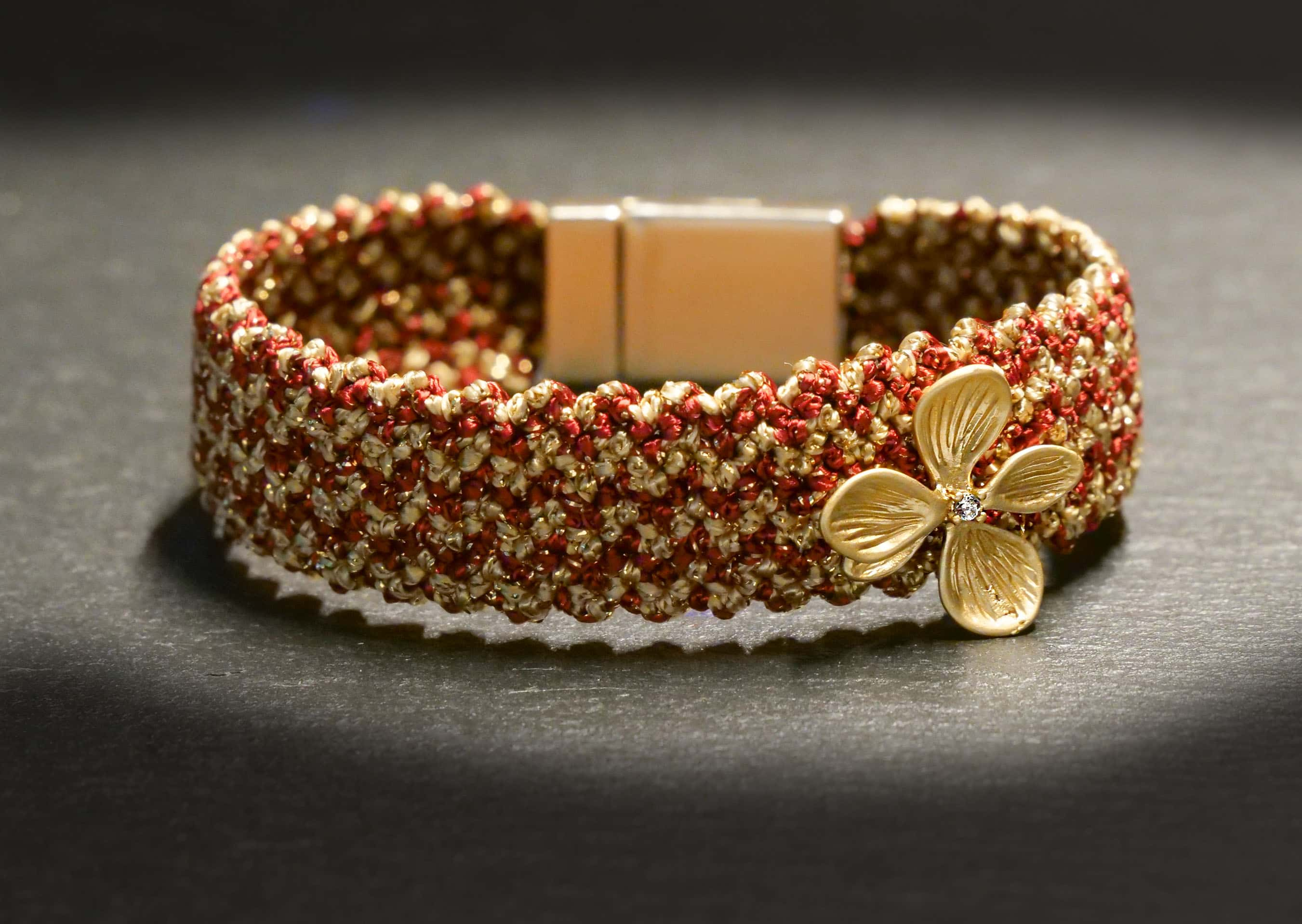 woven bracelet with flower pendant in bordeaux