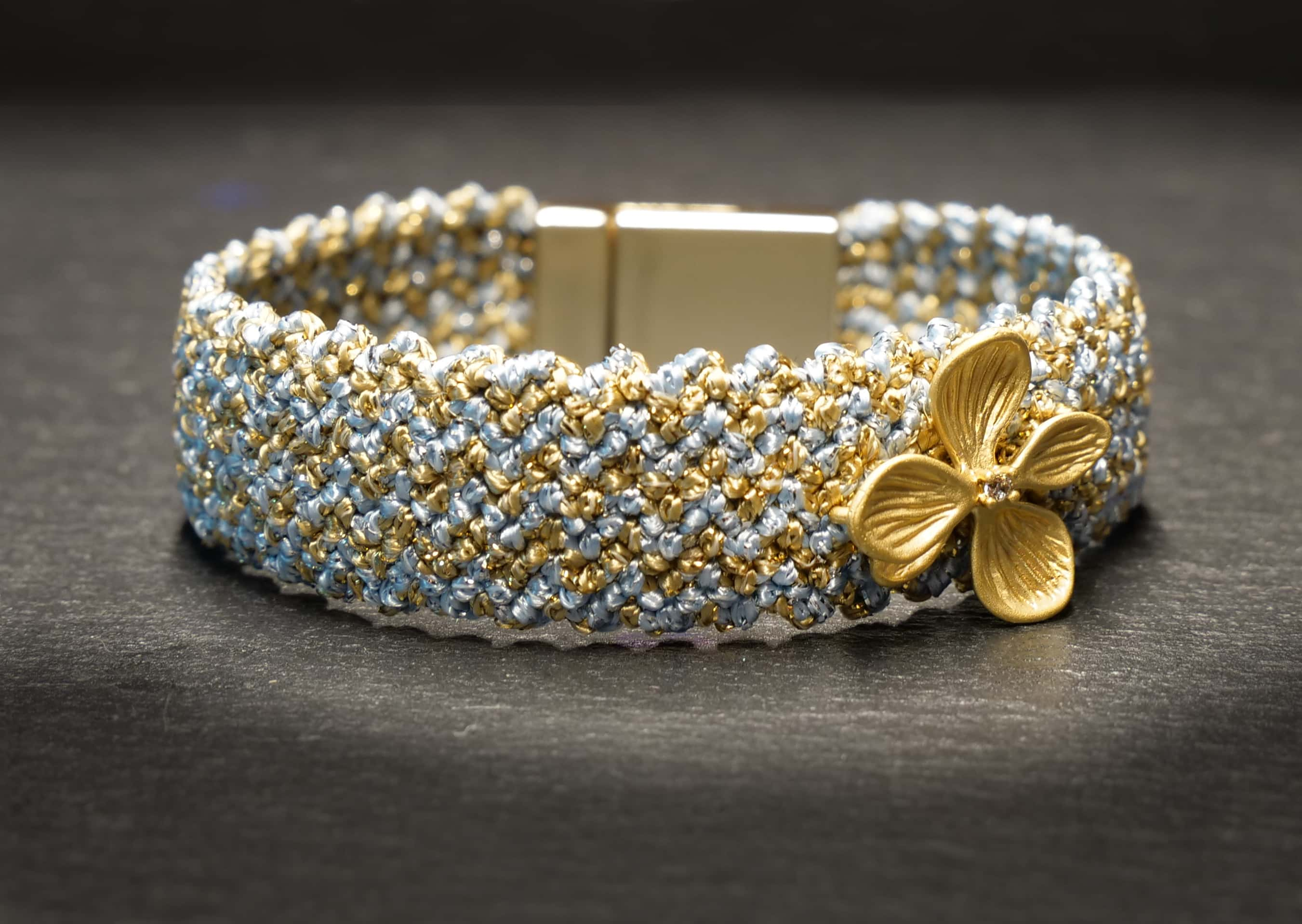 knotted bracelet in baby blue/gold
